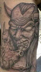 Demon eating heart black tattoo