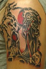 Grim reaper in cemetery tattoo