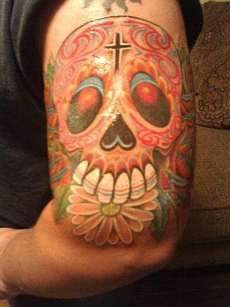 Dia de muertos skull coloured tattoo