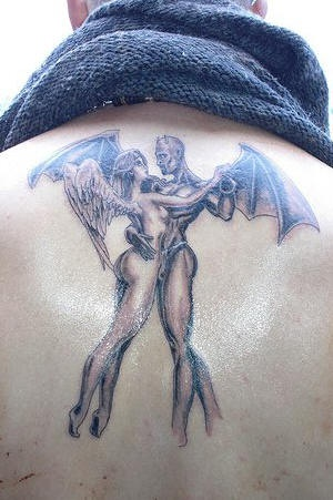 Dancing demons tattoo on back