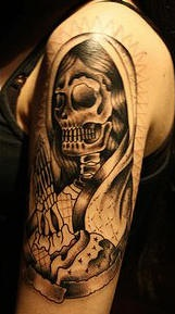 Praying death tattoo on arm