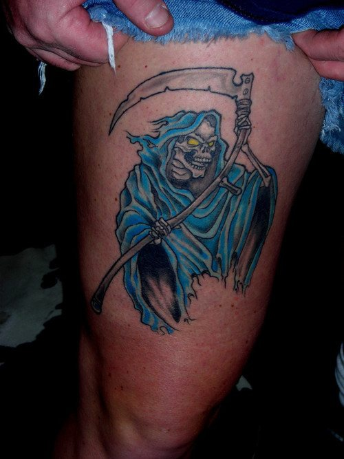 Coloured grim reaper tattoo
