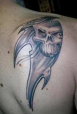 Tribal styvle death tattoo on shoulder