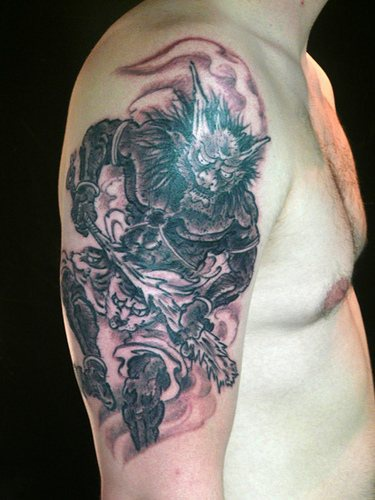 Asian style death demon tattoo
