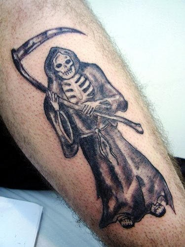 Grim reaper black ink tattoo