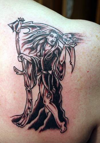 She-death tattoo on shoulder