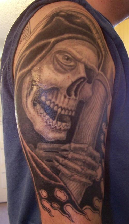 Smiling grim reaper tattoo