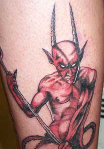 Horned red devil tattoo