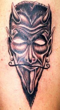 Horned devil mask tattoo