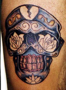 Dia de muertos style skull tattoo