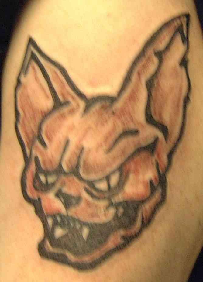 Laughing demonic creature tattoo