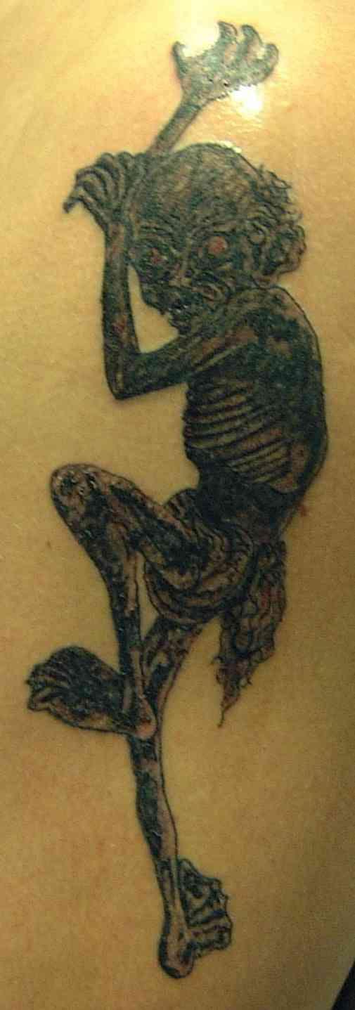 Ugly zombie demon tattoo