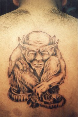 Old satyr tattoo on back