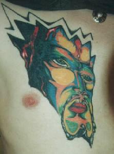 Surreal demon face coloured tattoo