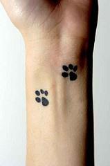 Doggy paw prints wrist tattoo
