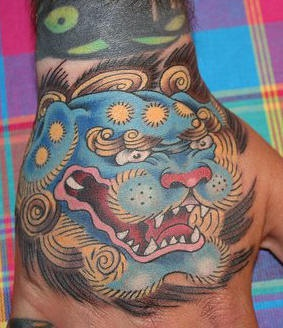 Chinese style chow-chow head hand tattoo