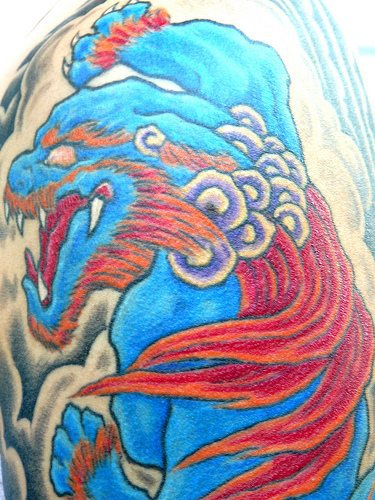 Chinese style chow-chow dog tattoo