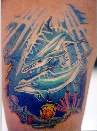 Tattoo design with dolphins in the ocean floor