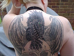 Large winged dragon on skull full back tattoo