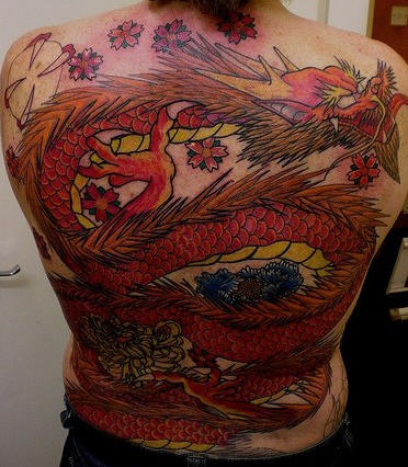 Dragon tattoo giant red monster on upper back