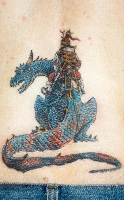 Tattoo of japanese warrior on blue dragon