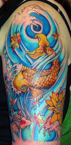 Golden koi fishes sleeve tattoo