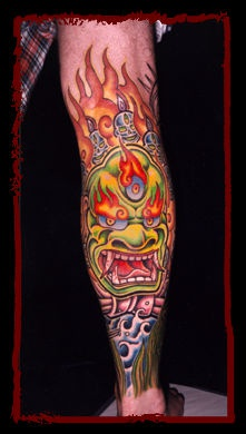 Chinese demon in flames coloured tattoo