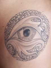 Eye with tracery in circle