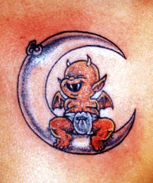 Little demon on moon tattoo