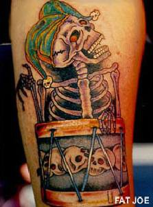Laughing skeleton with drums tattoo