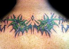 Green eye tracery on back