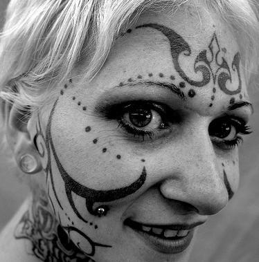 Curls & dots face tattoo design