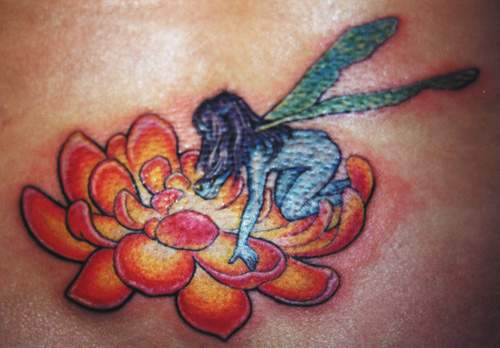 Blue fairy on orange flower tattoo