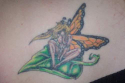 Sexy fairy on leaf coloured tattoo