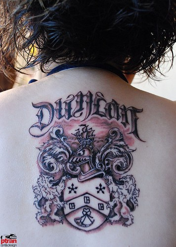 Family coat of arms tattoo on back