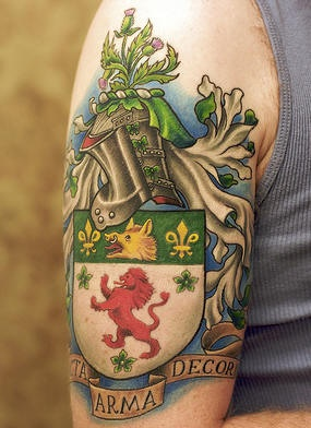 Family crest coloured arm tattoo