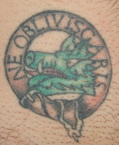 Ne obliviscaris family crest tattoo