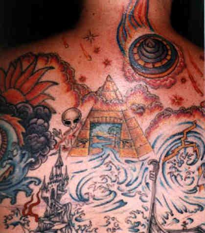 Surreal alien themed full back tattoo