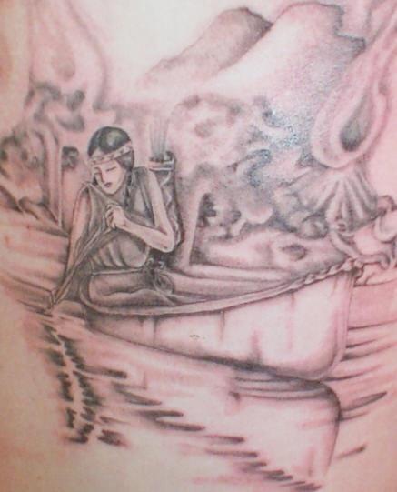 Native american girl in canoe tattoo