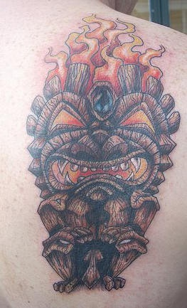 Wooden deity in flame coloured tattoo