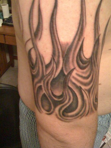 Classic flame black ink tattoo