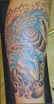 Big blue fish tattoo on hand