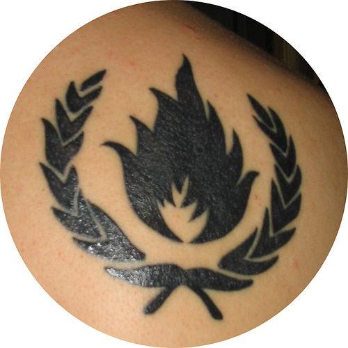 Fire in crown symbol tattoo