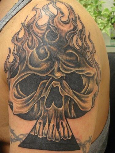 Flaming skull of spades tattoo