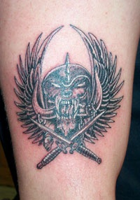 Wings skull and crossed knives  tattoo