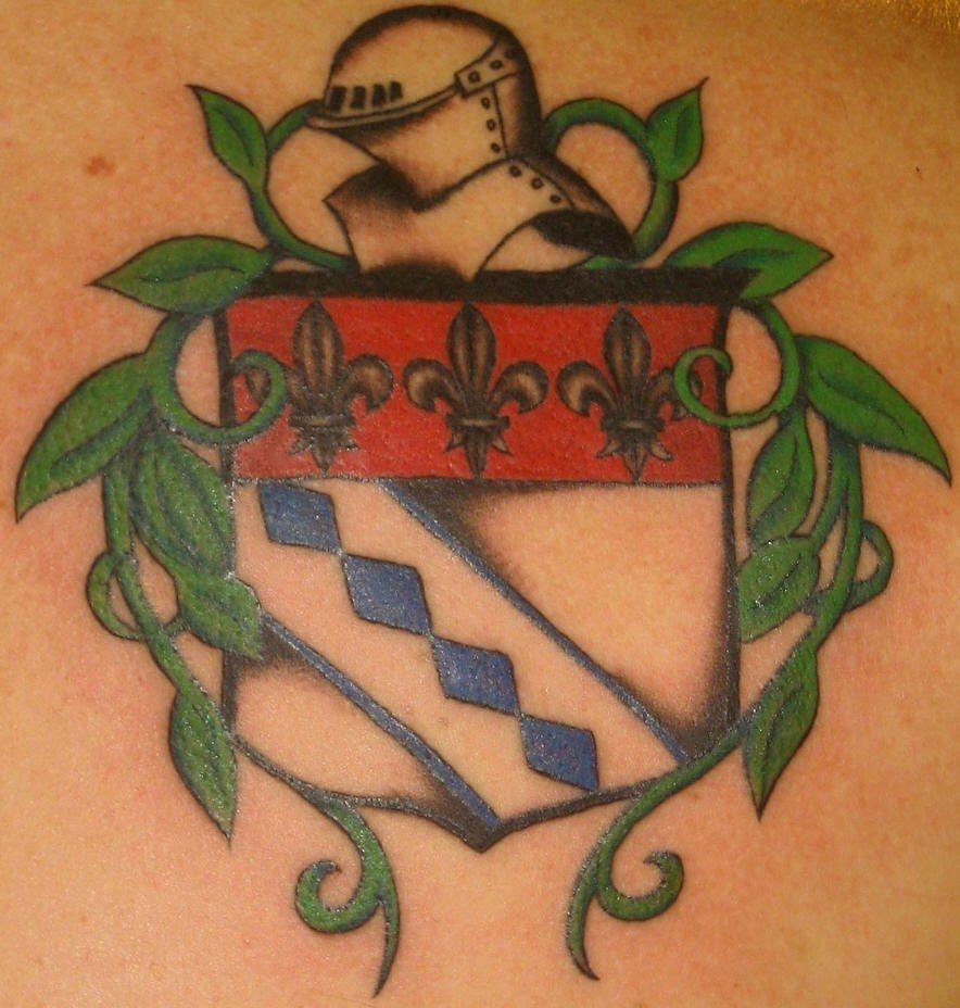 Fleur de lis on heraldic shield tattoo