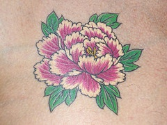 Gorgeous white and purple flower tattoo