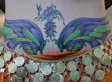 Stomach tattoo,beautiful blue and green  flower and butterfly