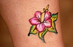 Minimalistic flower coloured tattoo