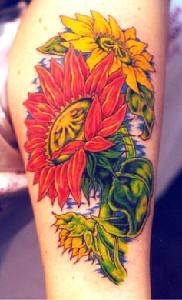 Yellow and red sunflowers tattoo